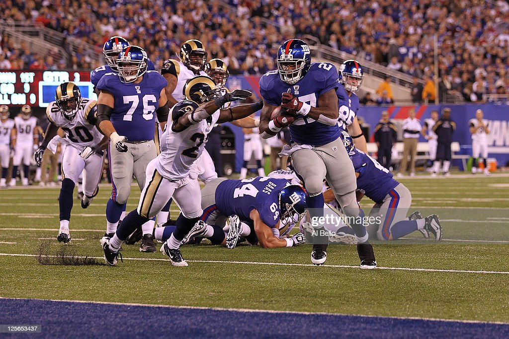 Brandon Jacobs #27 of the New York Giants scores a 9-yard rushing touchdown in the third quarter against the St. Louis Rams at MetLife Stadium on September 19, 2011 in East Rutherford, New Jersey.