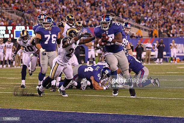 Brandon Jacobs of the New York Giants scores a 9yard rushing touchdown in the third quarter against the St Louis Rams at MetLife Stadium on September...