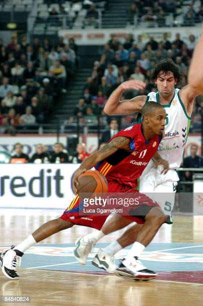 Brandon Jennings #11 of Lottomatica Roma competes with Berni Rodríguez #5 of Unicaja during the Euroleague Basketball Top 16 Game 1 match between...