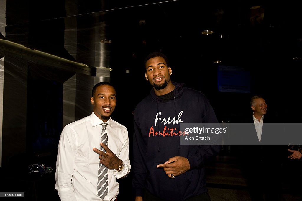 Brandon Jennings and Andre Drummond of the Detroit Piston poses for a photo at an introductory press conference on August 6, 2013 at Palace of Auburn Hills in Auburn Hills, Michigan.