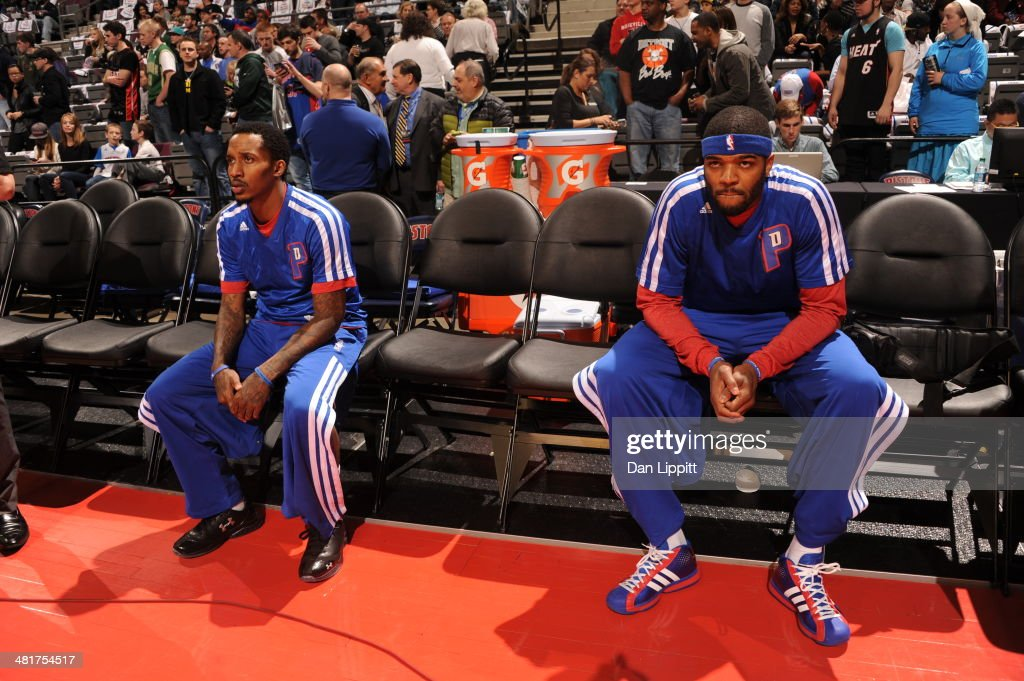 Brandon Jennings #7 and <a gi-track='captionPersonalityLinkClicked' href=/galleries/search?phrase=Josh+Smith+-+Basketball+Player+-+Born+1985&family=editorial&specificpeople=201983 ng-click='$event.stopPropagation()'>Josh Smith</a> #6 of the Detroit Pistons sit on the bench before the game against the Miami Heat on March 28, 2014 at The Palace of Auburn Hills in Auburn Hills, Michigan.