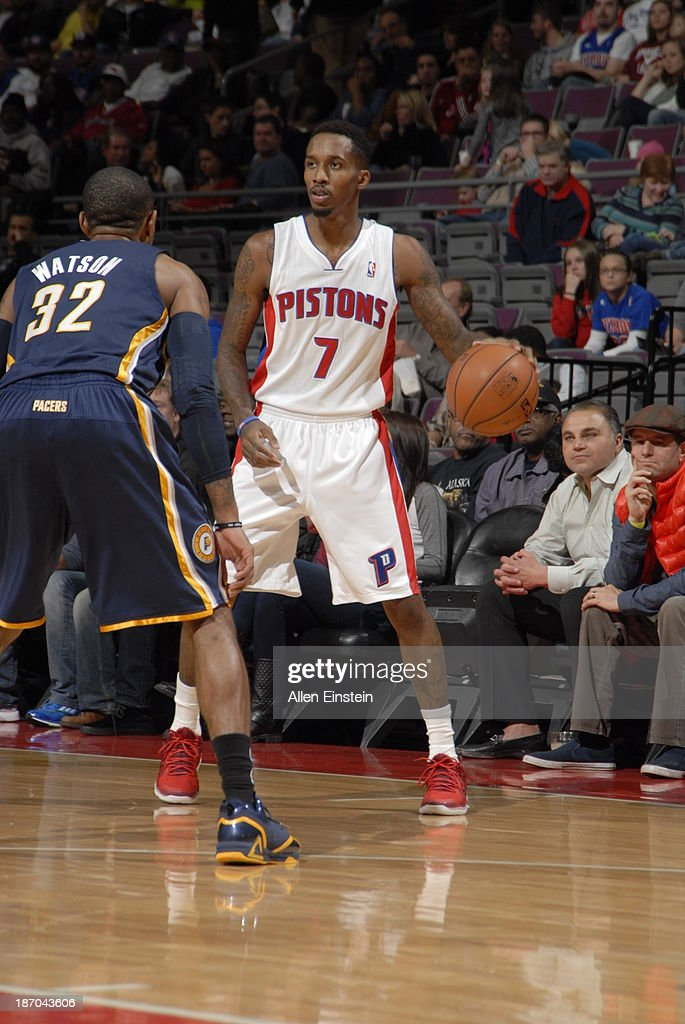Brandon Jennings of the Detroit Pistons handles the ball against CJ Watson of the Indiana Pacers on November 5 2013 at The Palace of Auburn Hills in...