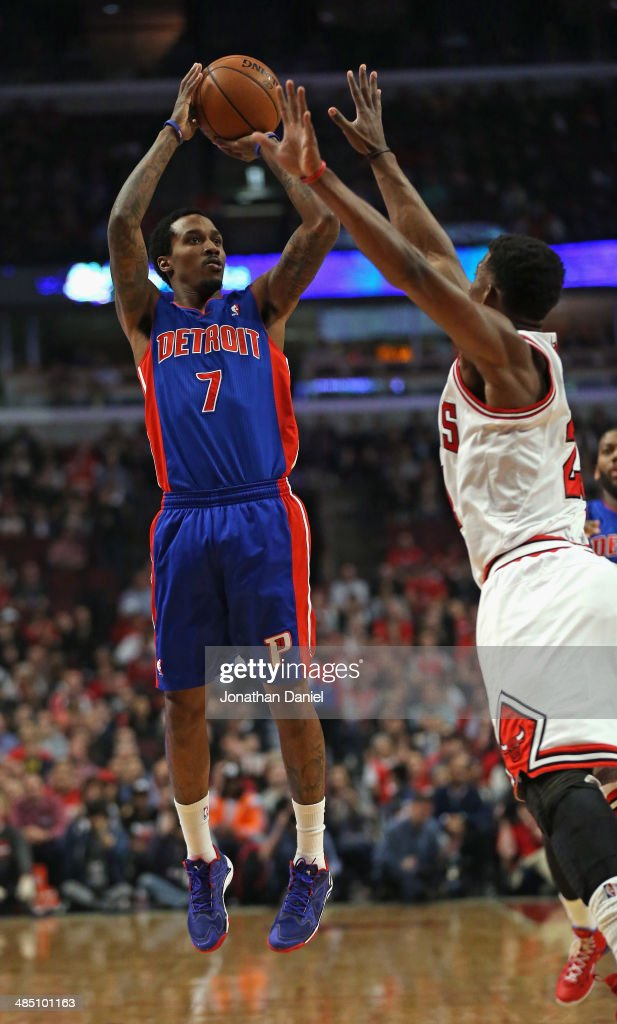 Brandon Jennings #7 of the Detroit Pistons shoots over Jimmy Butler #21 of the Chicago Bulls at the United Center on April 11, 2014 in Chicago, Illinois. The Bulls defeated the Pistons 106-98.