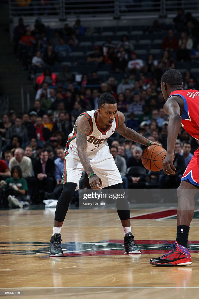Brandon Jennings #3 of the Milwaukee Bucks dribbles against <a gi-track='captionPersonalityLinkClicked' href=/galleries/search?phrase=Jrue+Holiday&family=editorial&specificpeople=5042484 ng-click='$event.stopPropagation()'>Jrue Holiday</a> #11 of the Philadelphia 76ers on January 22, 2013 at the BMO Harris Bradley Center in Milwaukee, Wisconsin.