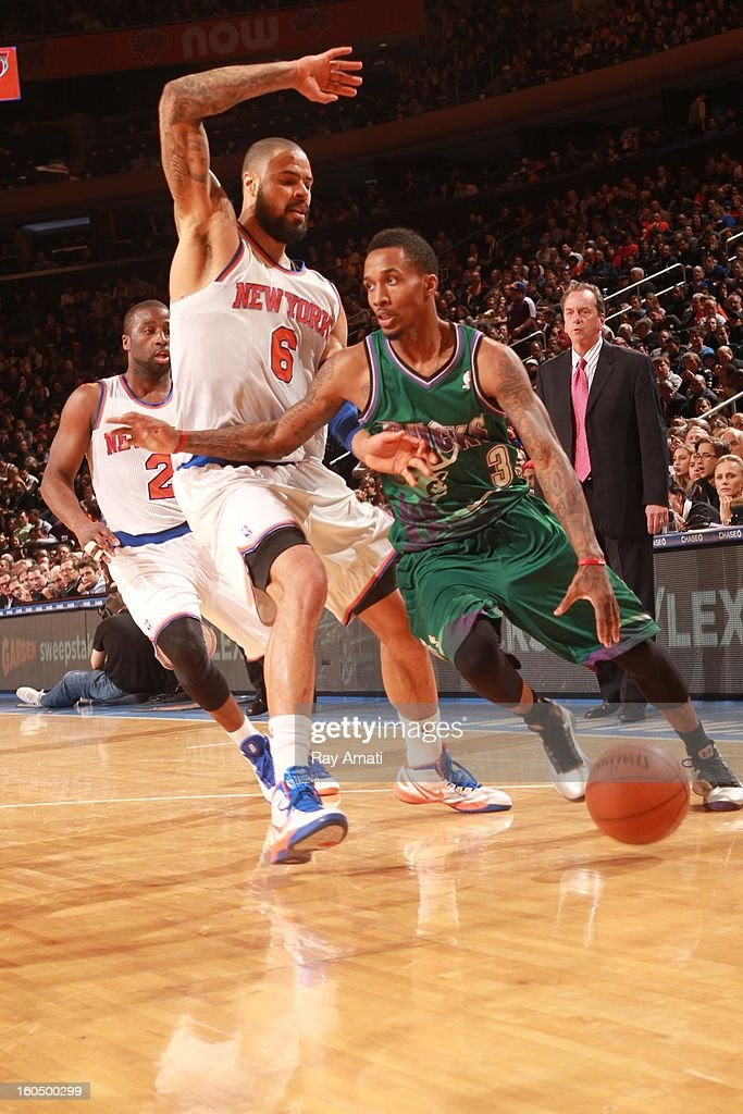 Brandon Jennings #3 of the Milwaukee Bucks drives against <a gi-track='captionPersonalityLinkClicked' href=/galleries/search?phrase=Tyson+Chandler&family=editorial&specificpeople=202061 ng-click='$event.stopPropagation()'>Tyson Chandler</a> #6 of the New York Knicks on February 1, 2013 at Madison Square Garden in New York City .