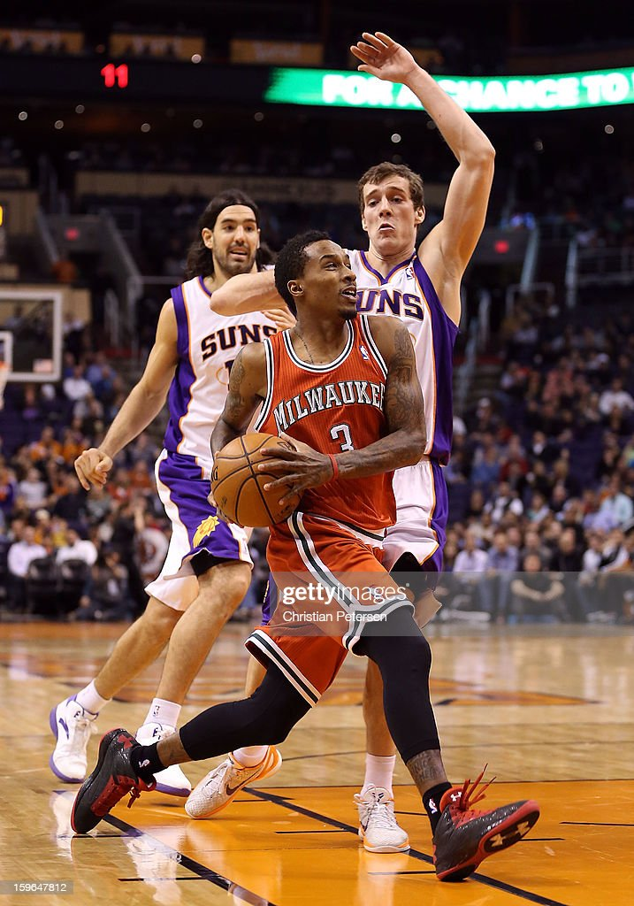 Brandon Jennings #3 of the Milwaukee Bucks drives the ball past Goran Dragic #1 of the Phoenix Suns during the NBA game at US Airways Center on January 17, 2013 in Phoenix, Arizona.