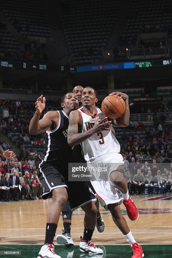 Brandon Jennings #3 of the Milwaukee Bucks drives to the basket against <a gi-track='captionPersonalityLinkClicked' href=/galleries/search?phrase=C.J.+Miles&family=editorial&specificpeople=641491 ng-click='$event.stopPropagation()'>C.J. Miles</a> #1 of the Brooklyn Nets on February 20, 2013 at the BMO Harris Bradley Center in Milwaukee, Wisconsin.