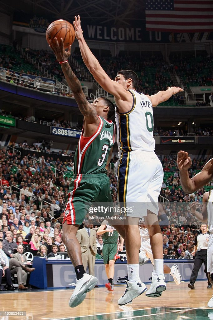 Brandon Jennings #3 of the Milwaukee Bucks drives to the hoop against <a gi-track='captionPersonalityLinkClicked' href=/galleries/search?phrase=Enes+Kanter&family=editorial&specificpeople=5621416 ng-click='$event.stopPropagation()'>Enes Kanter</a> #0 of the Utah Jazz at Energy Solutions Arena on February 06, 2013 in Salt Lake City, Utah.