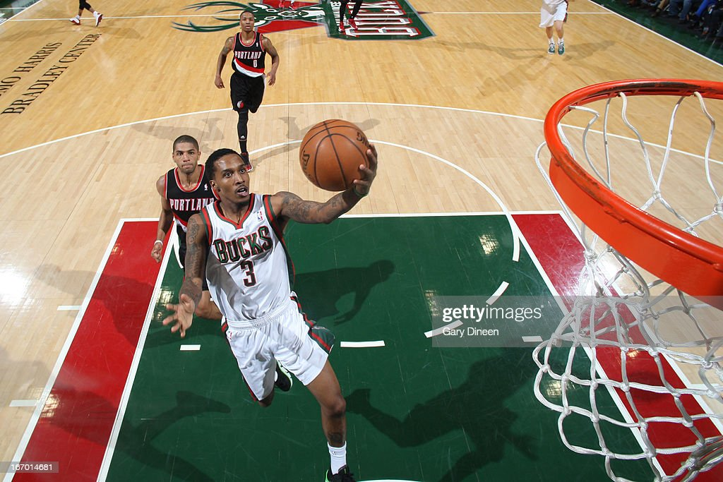 Brandon Jennings #3 of the Milwaukee Bucks glides to the basket against the Portland Trail Blazers on March 19, 2013 at the BMO Harris Bradley Center in Milwaukee, Wisconsin.