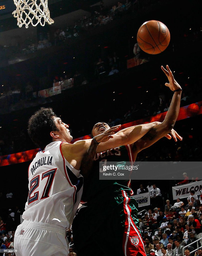 Brandon Jennings of the Milwaukee Bucks is fouled hard by Zaza Pachulia of the Atlanta Hawks during Game Five of the Eastern Conference Quarterfinals...