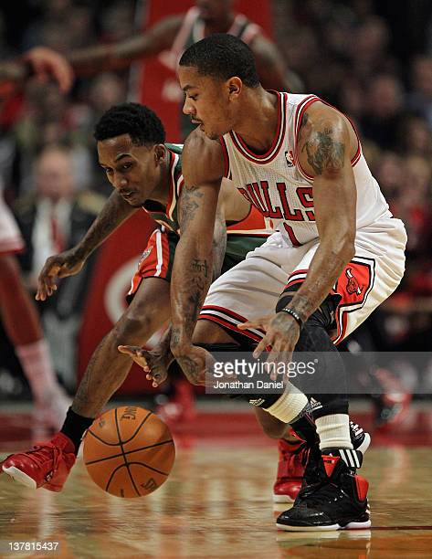 Brandon Jennings of the Milwaukee Bucks knocks the ball away from Derrick Rose of the Chicago Bulls at the United Center on January 27 2012 in...
