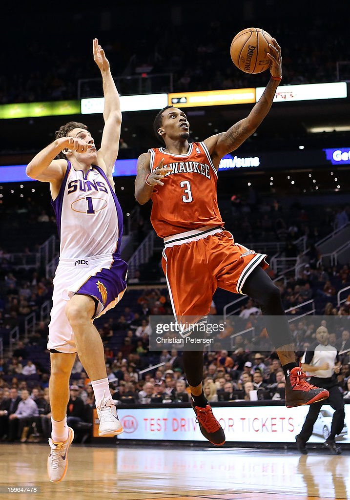 Brandon Jennings #3 of the Milwaukee Bucks lays up a shot past Goran Dragic #1 of the Phoenix Suns during the NBA game at US Airways Center on January 17, 2013 in Phoenix, Arizona.