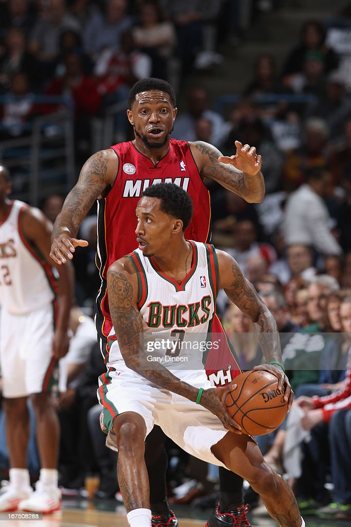Brandon Jennings #3 of the Milwaukee Bucks looks to pass the ball against Udonis Haslem #40 of the Miami Heat in Game Three of the Eastern Conference Quarterfinals during the 2013 NBA Playoffs on April 25, 2013 at the BMO Harris Bradley Center in Milwaukee, Wisconsin.