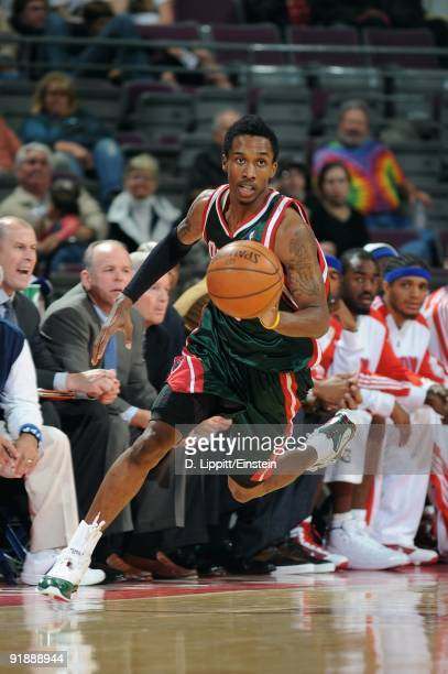 Brandon Jennings of the Milwaukee Bucks moves the ball against the Detroit Pistons during the preseason game at the Palace of Auburn Hills on October...