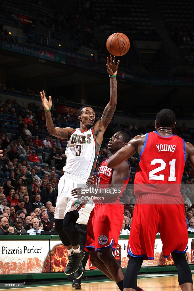 Brandon Jennings #3 of the Milwaukee Bucks passes against <a gi-track='captionPersonalityLinkClicked' href=/galleries/search?phrase=Jrue+Holiday&family=editorial&specificpeople=5042484 ng-click='$event.stopPropagation()'>Jrue Holiday</a> #11 of the Philadelphia 76ers on January 22, 2013 at the BMO Harris Bradley Center in Milwaukee, Wisconsin.