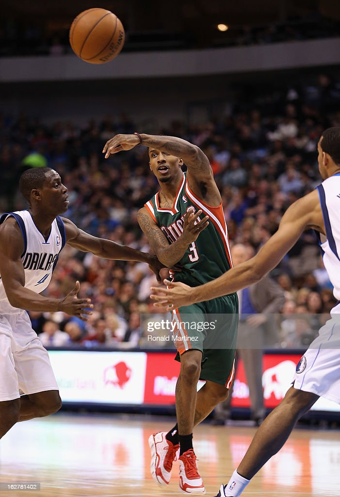Brandon Jennings #3 of the Milwaukee Bucks passes the ball against Darren Collison #4 of the Dallas Mavericks at American Airlines Center on February 26, 2013 in Dallas, Texas.