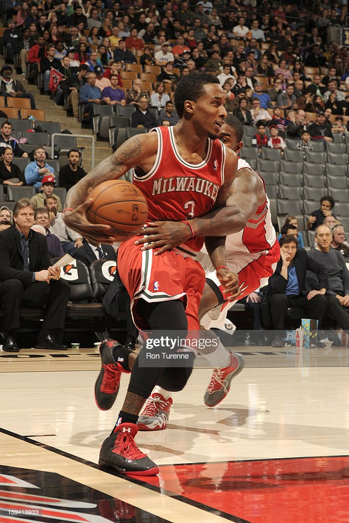 Brandon Jennings #3 of the Milwaukee Bucks protects the ball during the game between the Toronto Raptors and the Milwaukee Bucks on January 13, 2013 at the Air Canada Centre in Toronto, Ontario, Canada.