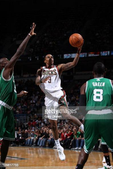 Brandon Jennings of the Milwaukee Bucks shoots a layup against Kevin Garnett of the Boston Celtics during the NBA game on March 6 2011 at the Bradley...