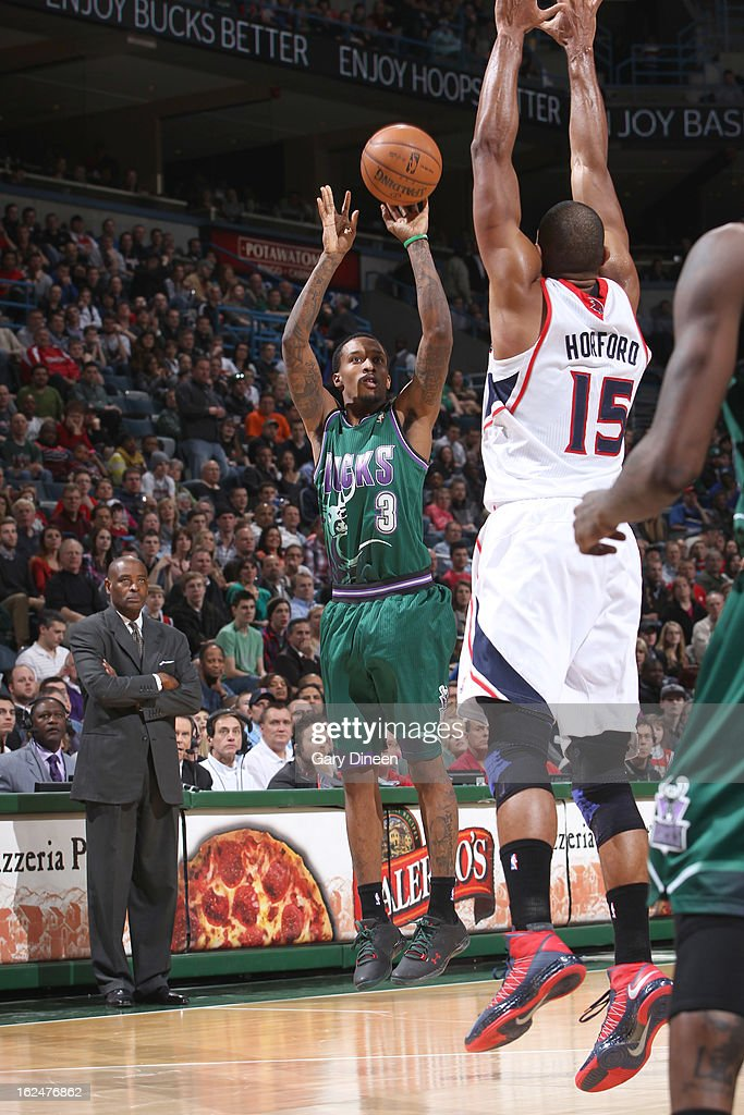 Brandon Jennings #3 of the Milwaukee Bucks shoots against <a gi-track='captionPersonalityLinkClicked' href=/galleries/search?phrase=Al+Horford&family=editorial&specificpeople=699030 ng-click='$event.stopPropagation()'>Al Horford</a> #15 of the Atlanta Hawks on February 23, 2013 at the BMO Harris Bradley Center in Milwaukee, Wisconsin.