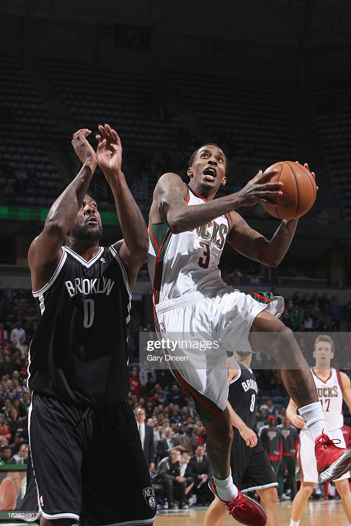 Brandon Jennings #3 of the Milwaukee Bucks shoots against <a gi-track='captionPersonalityLinkClicked' href=/galleries/search?phrase=Andray+Blatche&family=editorial&specificpeople=4282797 ng-click='$event.stopPropagation()'>Andray Blatche</a> #0 of the Brooklyn Nets on February 20, 2013 at the BMO Harris Bradley Center in Milwaukee, Wisconsin.