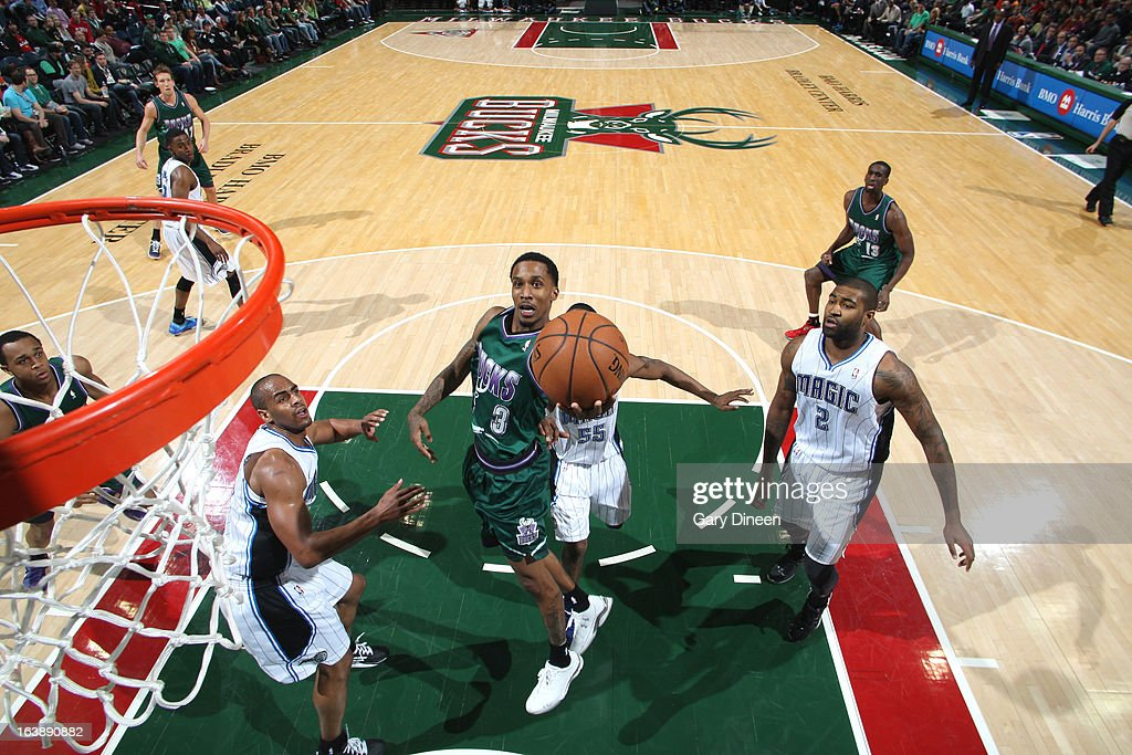 Brandon Jennings #3 of the Milwaukee Bucks shoots against <a gi-track='captionPersonalityLinkClicked' href=/galleries/search?phrase=Arron+Afflalo&family=editorial&specificpeople=640861 ng-click='$event.stopPropagation()'>Arron Afflalo</a> #4 of the Orlando Magic on March 17, 2013 at the BMO Harris Bradley Center in Milwaukee, Wisconsin.