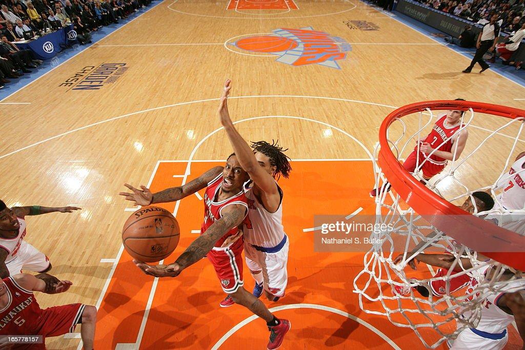 Brandon Jennings #3 of the Milwaukee Bucks shoots against Chris Copeland #14 of the New York Knicks on April 5, 2013 at Madison Square Garden in New York City.