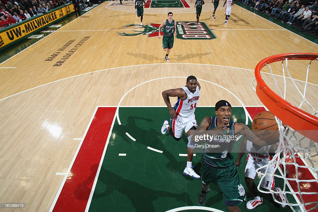 Brandon Jennings #3 of the Milwaukee Bucks shoots against (L-R) <a gi-track='captionPersonalityLinkClicked' href=/galleries/search?phrase=Jason+Maxiell&family=editorial&specificpeople=651723 ng-click='$event.stopPropagation()'>Jason Maxiell</a> #54 and <a gi-track='captionPersonalityLinkClicked' href=/galleries/search?phrase=Will+Bynum&family=editorial&specificpeople=212891 ng-click='$event.stopPropagation()'>Will Bynum</a> #12 of the Detroit Pistons on February 9, 2013 at the BMO Harris Bradley Center in Milwaukee, Wisconsin.