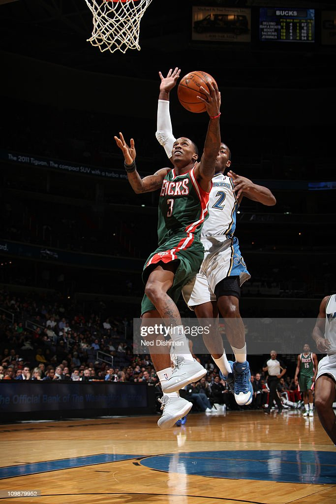 Brandon Jennings #3 of the Milwaukee Bucks shoots against <a gi-track='captionPersonalityLinkClicked' href=/galleries/search?phrase=John+Wall&family=editorial&specificpeople=2265812 ng-click='$event.stopPropagation()'>John Wall</a> #2 of the Washington Wizards during the game at the Verizon Center on March 8, 2011 in Washington, DC.