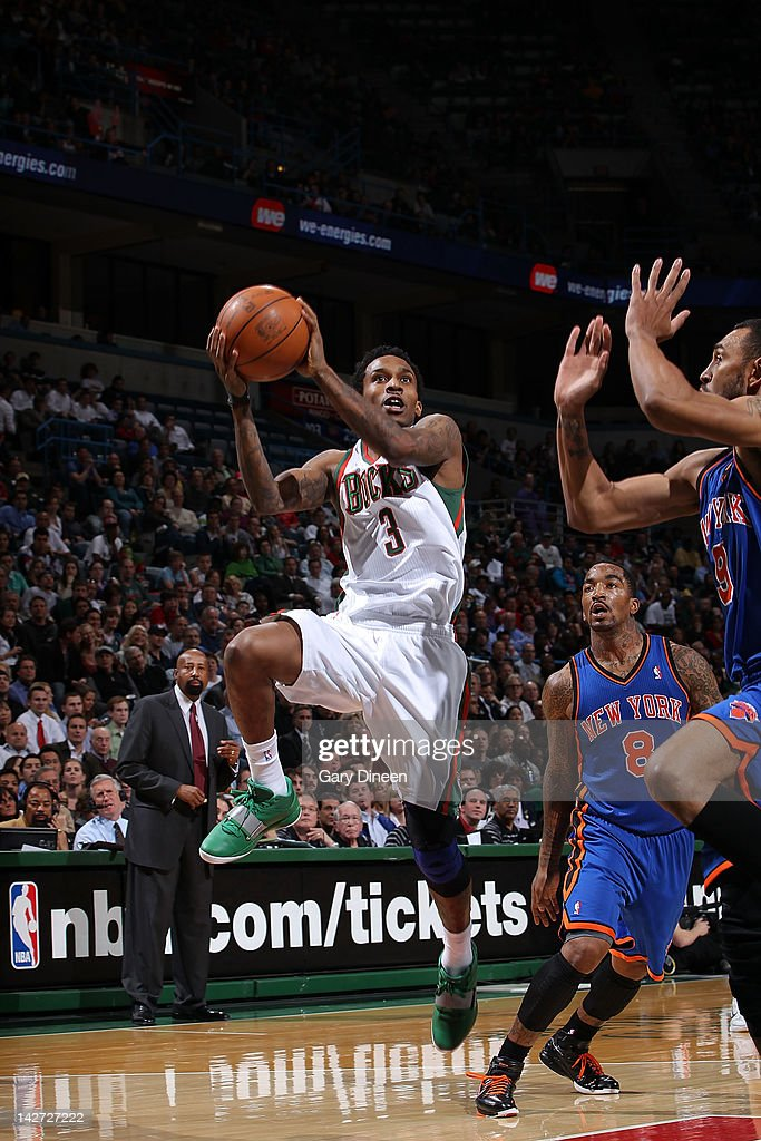 Brandon Jennings #3 of the Milwaukee Bucks shoots against (L-R) <a gi-track='captionPersonalityLinkClicked' href=/galleries/search?phrase=J.R.+Smith&family=editorial&specificpeople=201766 ng-click='$event.stopPropagation()'>J.R. Smith</a> #8 and <a gi-track='captionPersonalityLinkClicked' href=/galleries/search?phrase=Jared+Jeffries&family=editorial&specificpeople=202548 ng-click='$event.stopPropagation()'>Jared Jeffries</a> #9 of the New York Knicks on April 11, 2012 at the Bradley Center in Milwaukee, Wisconsin.