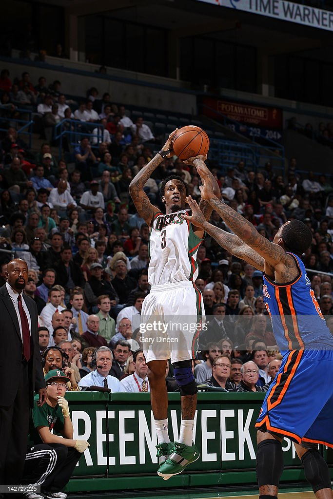 Brandon Jennings #3 of the Milwaukee Bucks shoots against <a gi-track='captionPersonalityLinkClicked' href=/galleries/search?phrase=J.R.+Smith&family=editorial&specificpeople=201766 ng-click='$event.stopPropagation()'>J.R. Smith</a> #8 of the New York Knicks on April 11, 2012 at the Bradley Center in Milwaukee, Wisconsin.