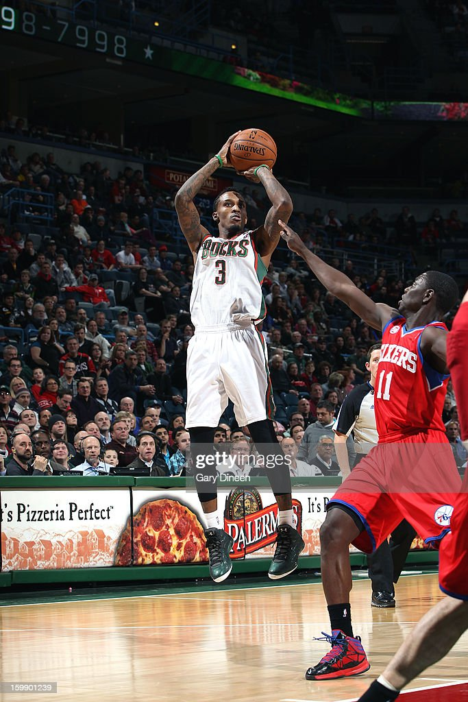 Brandon Jennings #3 of the Milwaukee Bucks shoots against <a gi-track='captionPersonalityLinkClicked' href=/galleries/search?phrase=Jrue+Holiday&family=editorial&specificpeople=5042484 ng-click='$event.stopPropagation()'>Jrue Holiday</a> #11 of the Philadelphia 76ers on January 22, 2013 at the BMO Harris Bradley Center in Milwaukee, Wisconsin.