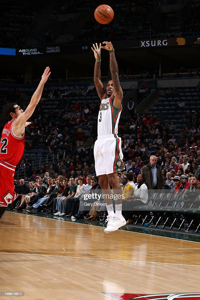 Brandon Jennings #3 of the Milwaukee Bucks shoots against <a gi-track='captionPersonalityLinkClicked' href=/galleries/search?phrase=Kirk+Hinrich&family=editorial&specificpeople=201629 ng-click='$event.stopPropagation()'>Kirk Hinrich</a> #12 of the Chicago Bulls during the NBA game on November 24, 2012 at the BMO Harris Bradley Center in Milwaukee, Wisconsin.