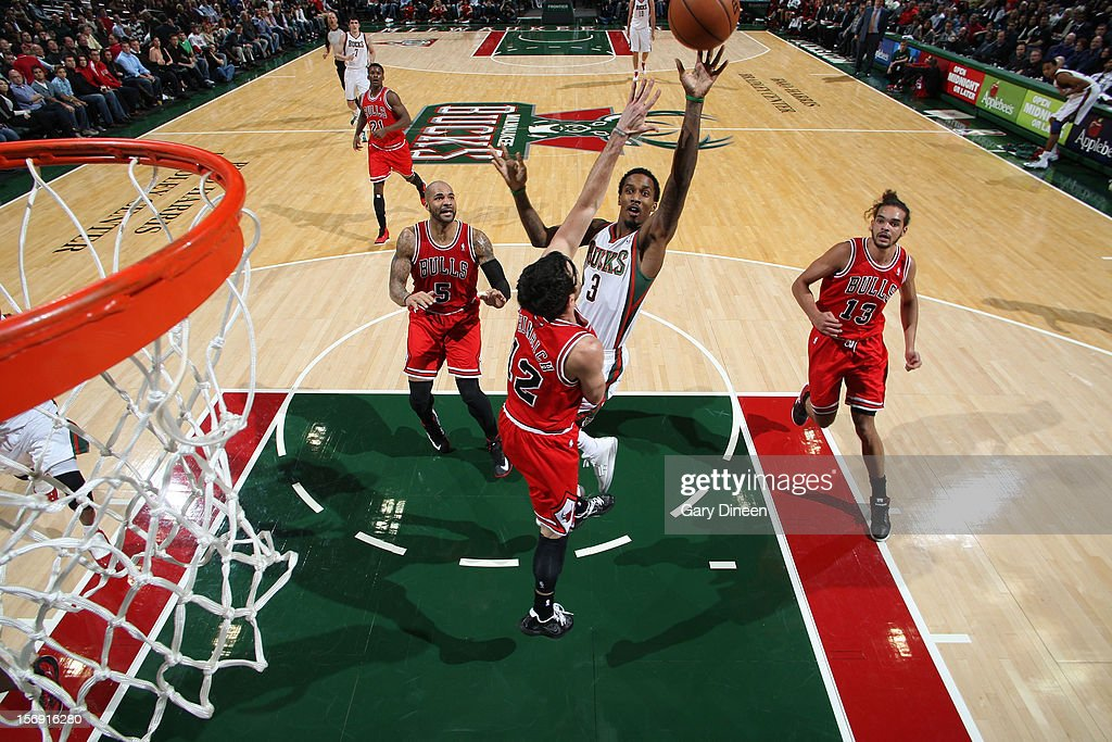 Brandon Jennings #3 of the Milwaukee Bucks shoots against Kirk Hinrich #12 of the Chicago Bulls during the NBA game on November 24, 2012 at the BMO Harris Bradley Center in Milwaukee, Wisconsin.