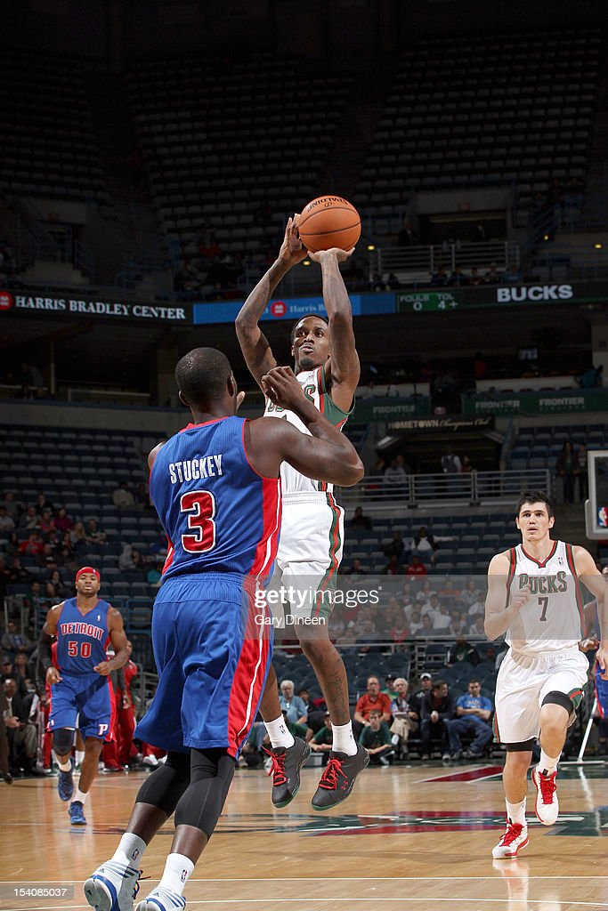 Brandon Jennings #3 of the Milwaukee Bucks shoots against <a gi-track='captionPersonalityLinkClicked' href=/galleries/search?phrase=Rodney+Stuckey&family=editorial&specificpeople=4375687 ng-click='$event.stopPropagation()'>Rodney Stuckey</a> #3 of the Detroit Pistons during the NBA preseason game on October 13, 2012 at the BMO Harris Bradley Center in Milwaukee, Wisconsin.