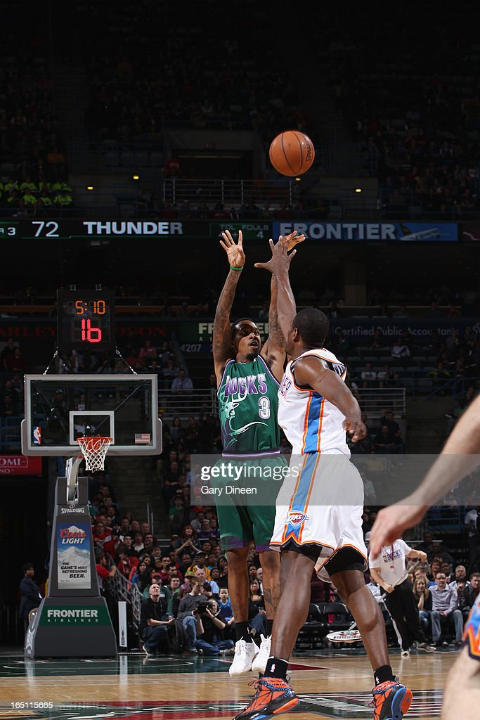 Brandon Jennings #3 of the Milwaukee Bucks shoots against <a gi-track='captionPersonalityLinkClicked' href=/galleries/search?phrase=Serge+Ibaka&family=editorial&specificpeople=5133378 ng-click='$event.stopPropagation()'>Serge Ibaka</a> #9 of the Oklahoma City Thunder on March 30, 2013 at the BMO Harris Bradley Center in Milwaukee, Wisconsin.