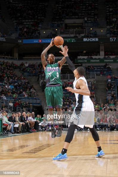 Brandon Jennings of the Milwaukee Bucks shoots against Tobias Harris of the Orlando Magic on March 17 2013 at the BMO Harris Bradley Center in...