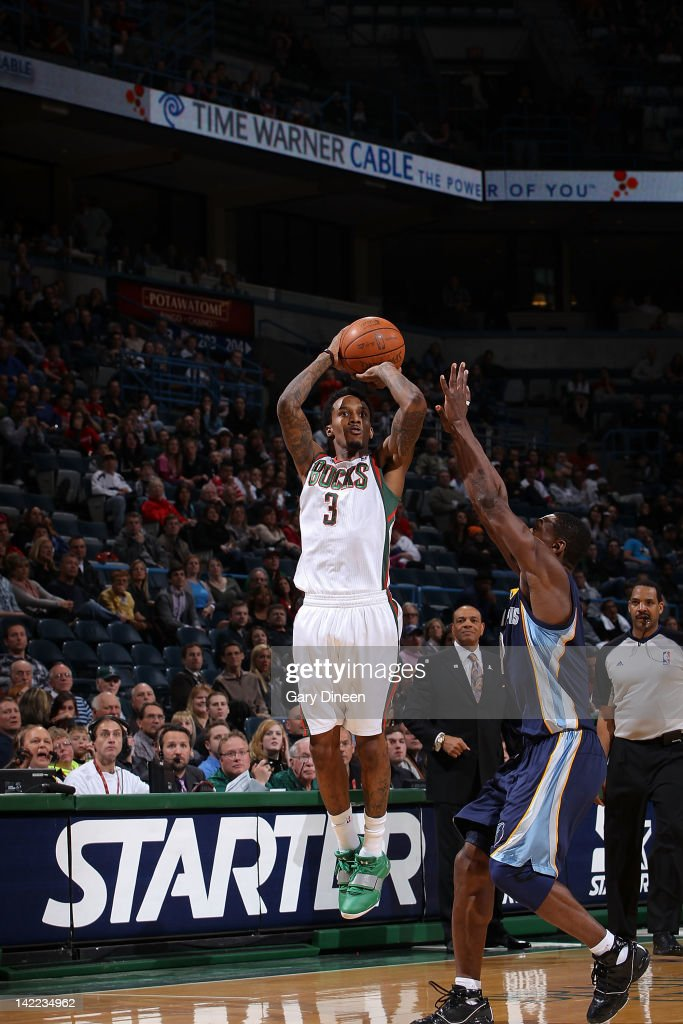 Brandon Jennings #3 of the Milwaukee Bucks shoots against <a gi-track='captionPersonalityLinkClicked' href=/galleries/search?phrase=Tony+Allen+-+Basketball+Player&family=editorial&specificpeople=201665 ng-click='$event.stopPropagation()'>Tony Allen</a> #9 of the Memphis Grizzlies on March 31, 2012 at the Bradley Center in Milwaukee, Wisconsin.