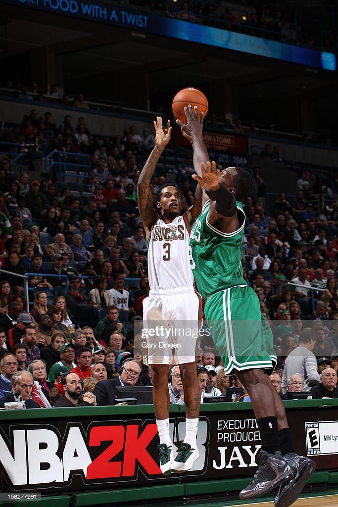 Brandon Jennings #3 of the Milwaukee Bucks takes a shot over Jeff Green #8 of the Boston Celtics on November 10, 2012 at the BMO Harris Bradley Center in Milwaukee, Wisconsin.