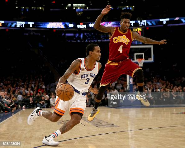 Brandon Jennings of the New York Knicks heads for the net as Iman Shumpert of the Cleveland Cavaliers defends at Madison Square Garden on December 7...