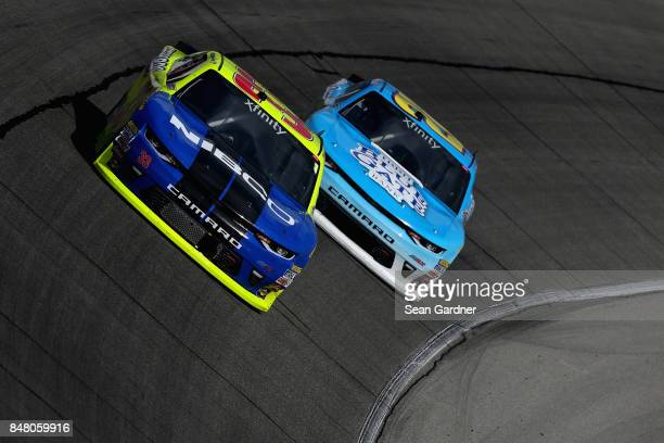 Brandon Jones driver of the NIBCO/Menards Chevrolet leads Daniel Hemric driver of the Blue Gate Bank Chevrolet during the NASCAR XFINITY Series...