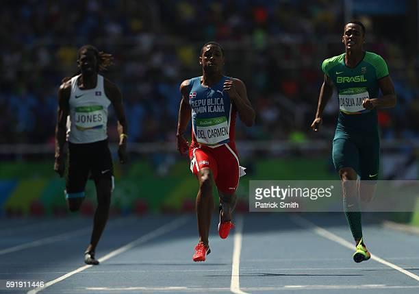 Brandon Jones of Belize Stanly del Carmen of the Dominican Republic and Aldemir Da Silva Junior of Brazil compete during the Men's 200m Round 1 on...