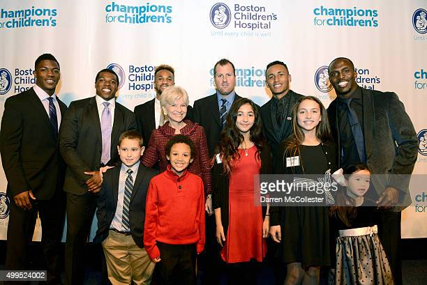 Brandon King Jordan Richards Darius Barnes Sandra Fenwich Dan Lacouture Juan Agudelo and Devin McCourty with Jackson Kobe Amita Jen and Elliott at...