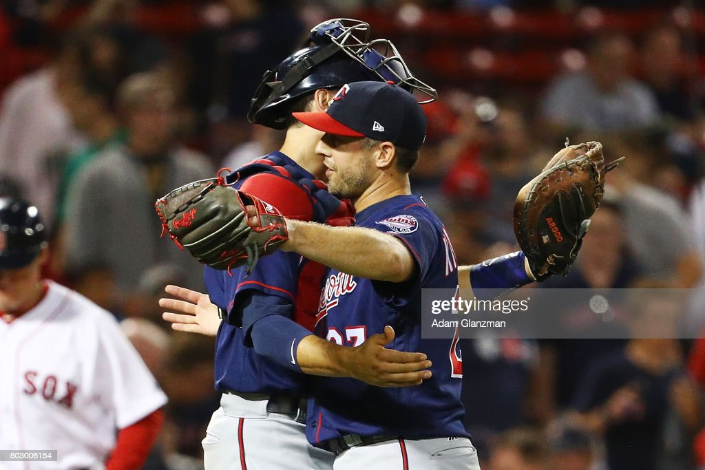 Brandon Kintzler #27 embraces Jason Castro #21 of the Minnesota Twins after their victory over the Boston Red Sox at Fenway Park on June 28, 2017 in Boston, Massachusetts.