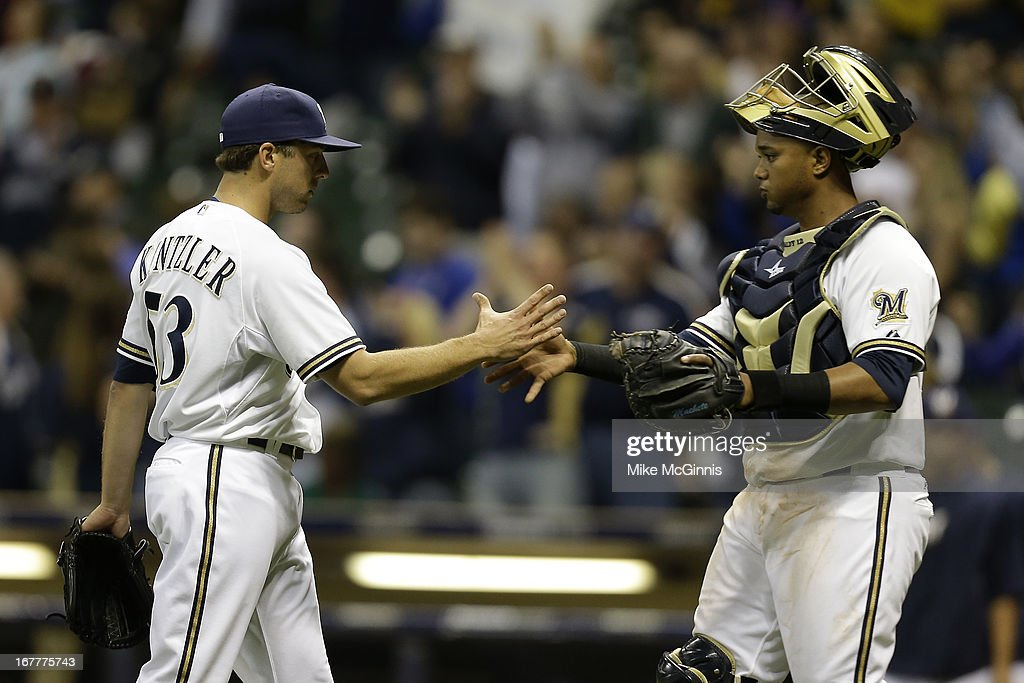 <a gi-track='captionPersonalityLinkClicked' href=/galleries/search?phrase=Brandon+Kintzler&family=editorial&specificpeople=7520465 ng-click='$event.stopPropagation()'>Brandon Kintzler</a> #53 of the Milwaukee Brewers celebrates with Martin Maldonado #12 after the 10-4 win over the Pittsburgh Pirates during the game at Miller Park on April 29, 2013 in Milwaukee, Wisconsin.