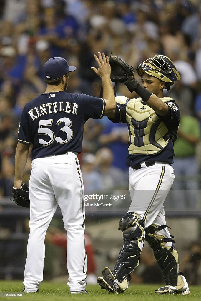 Brandon Kintzler #53 of the Milwaukee Brewers celebrates with Martin Maldonado #12 after the 6-1win over the Toronto Blue Jays during the Interleague game at Miller Park on August 19, 2014 in Milwaukee, Wisconsin.