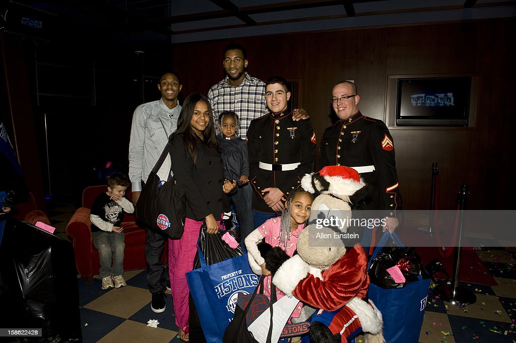 Brandon Knight, and Andre Drummond of the Detroit Pistons, their mascot Hooper, and U.S. Marines pass out holiday presents during the Detroit Pistons Toys for Tots Holiday event for metro Detroit families at the Palace of Auburn Hills on December 20, 2012 in Auburn Hills, Michigan.