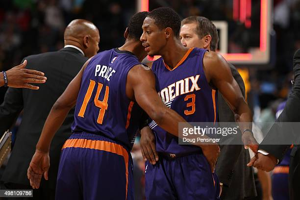 Brandon Knight and Ronnie Price of the Phoenix Suns celebrate their victory over the Denver Nuggets at Pepsi Center on November 20 2015 in Denver...