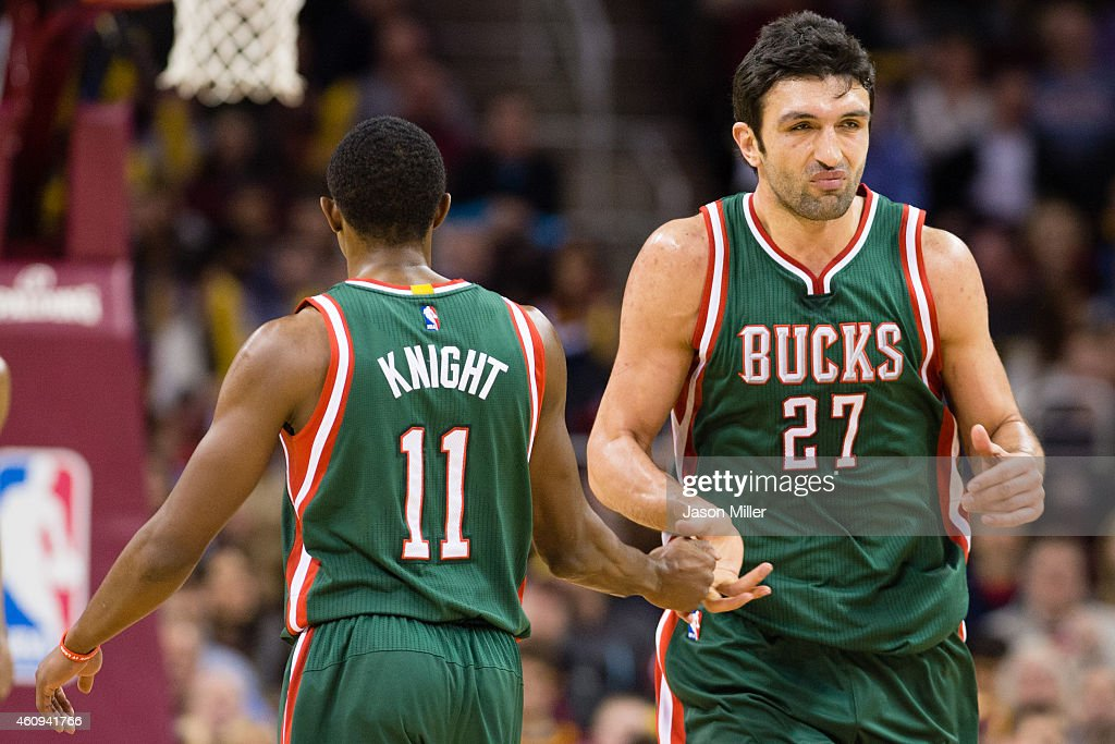 Brandon Knight and Zaza Pachulia of the Milwaukee Bucks celebrate after Pachulia scored during the second half against the Cleveland Cavaliers at...