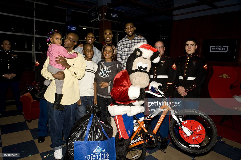 Brandon Knight, Corey Maggette, and Andre Drummond of the Detroit Pistons, their mascot Hooper, and U.S. Marines pass out holiday presents during the Detroit Pistons Toys for Tots Holiday event for metro Detroit families at the Palace of Auburn Hills on December 20, 2012 in Auburn Hills, Michigan. User expressly acknowledges and agrees that, by downloading and/or using this Photograph, user is consenting to the terms and conditions of the Getty Images License Agreement. Mandatory Copyright Notice: Copyright 2012 NBAE