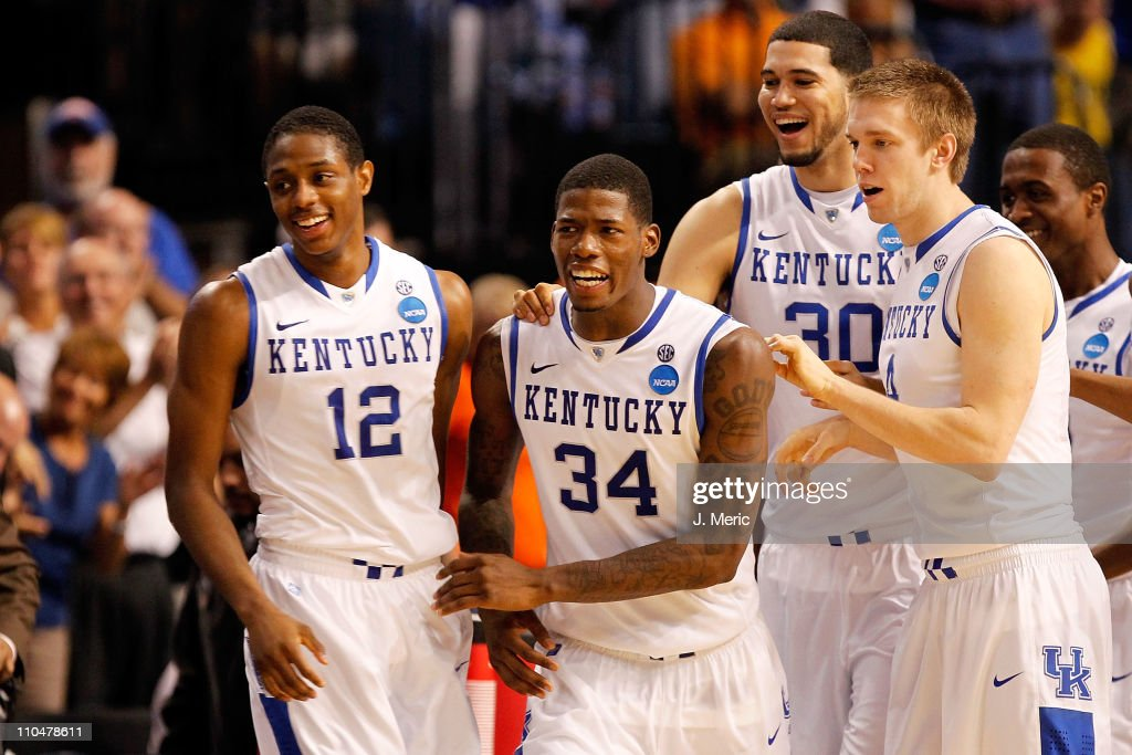 Brandon Knight DeAndre Liggins Eloy Vargas and Jon Hood of the Kentucky Wildcats celebrate after they won 7163 against the West Virginia Mountaineers...